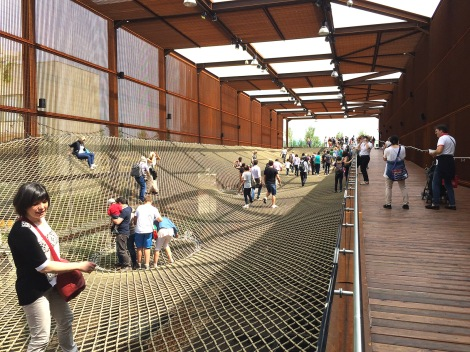 Visitors explore walking on the netting at the Brazil pavilion.